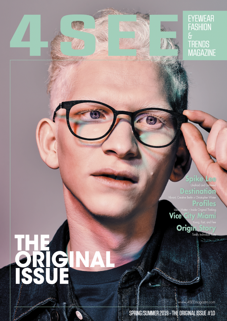 albino male model with short white hair wearing Lindberg eyewear