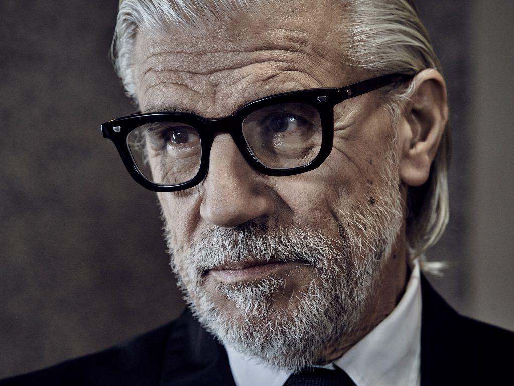 Editorial photo shoot featuring Max Pittion eyewear. gentleman wearing stylish black optical eyewear