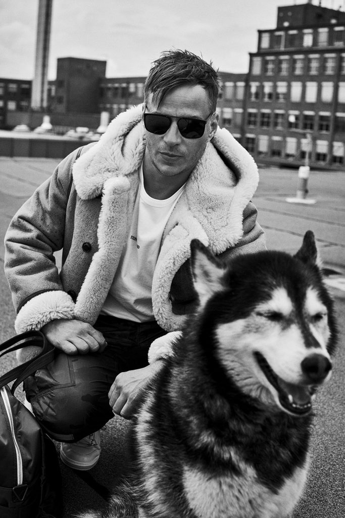 Tom Wlaschiha with husky dog