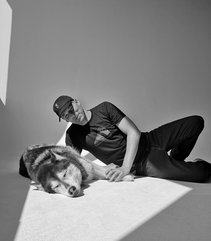 Professional Photographer Bert Spangemacher with Husky Cooper at his studio in Berlin